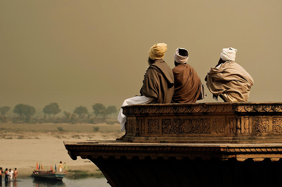 Three Sadhus Meditating By The Yamuna Photograph by Globalstock