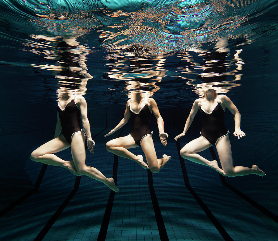 Three Synchronised Swimmers In Line Photograph by Henrik Sorensen