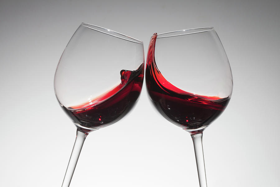 Toasting With Two Glasses Of Red Wine Photograph by Dual Dual