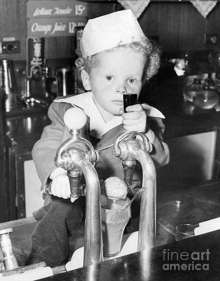 Toddler Making Ice Cream Soda Photograph by Bettmann
