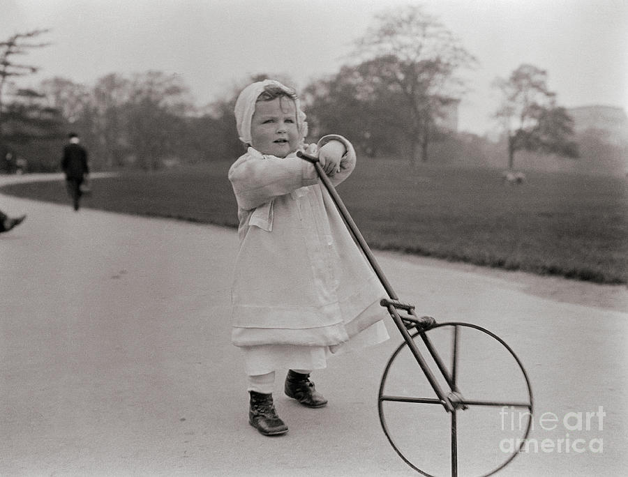 Toddler Playing With Unicycle Photograph by Bettmann