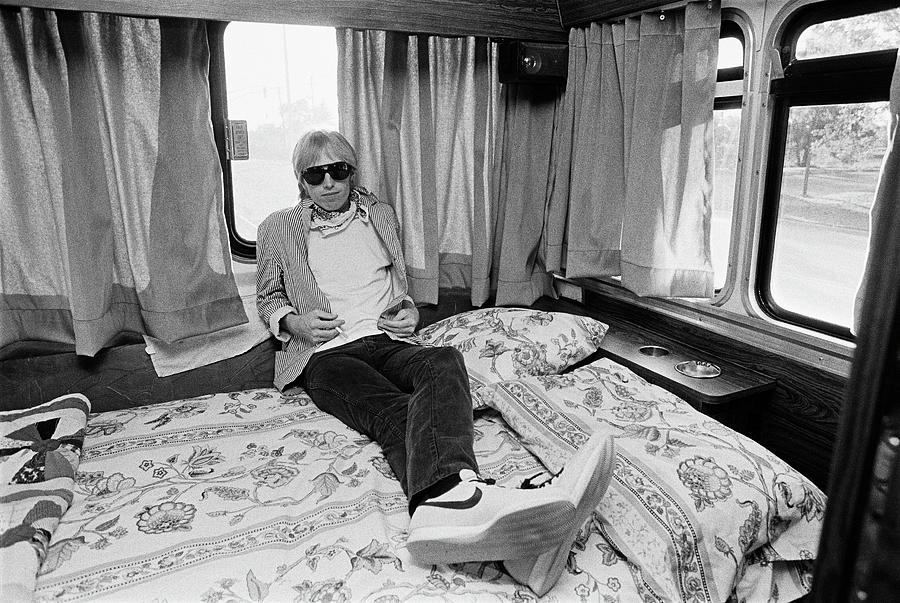 Tom Petty Poses In His Tour Bus Photograph by George Rose