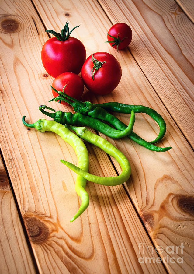 Tomatoes And Peppers On Wooden Table Photograph