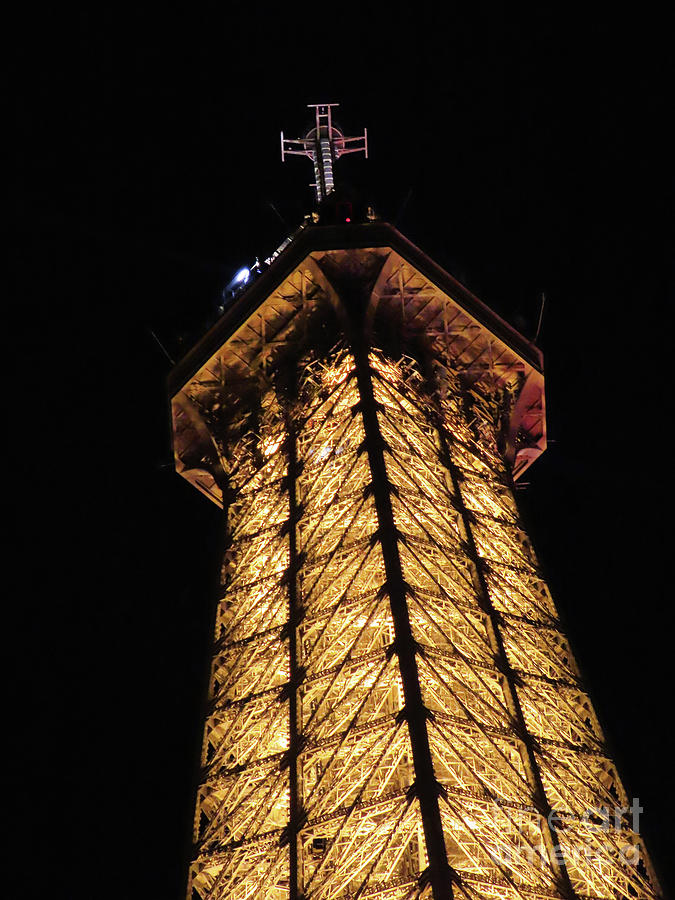 top of the Eiffel Tower at night by Steven Spak