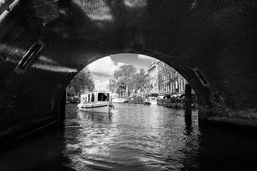 Boat Photograph - Tourboat On Amsterdam Canal by Bradley Hebdon