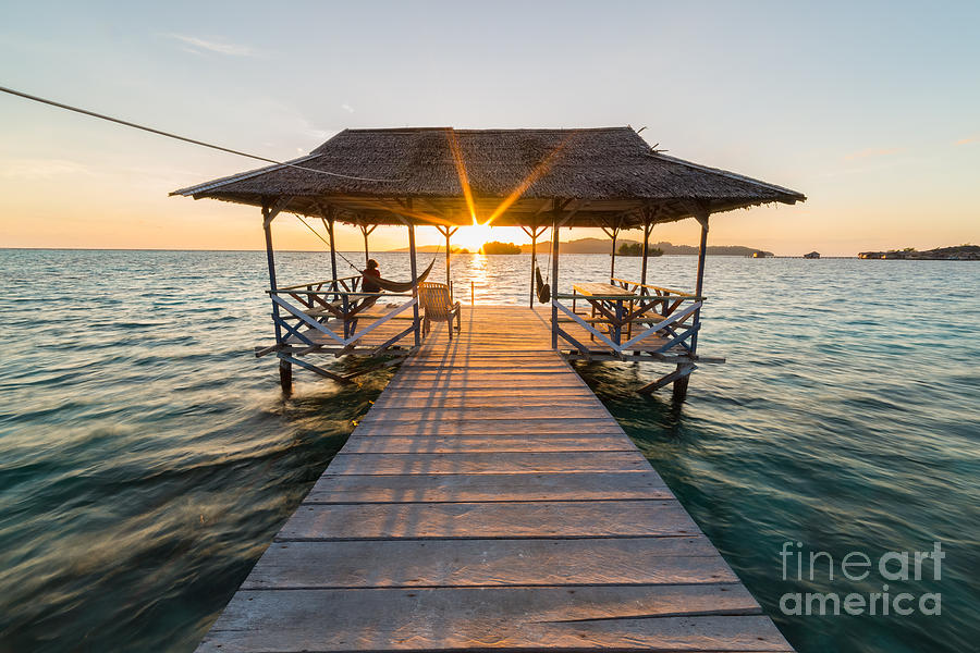 Dusk Photograph - Tourist Sitting On Wooden Jetty While by Fabio Lamanna