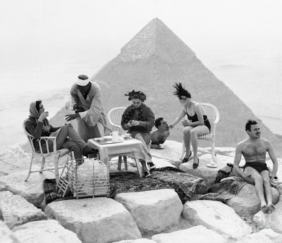 Tourists On Top Of Great Pyramid Photograph by Bettmann