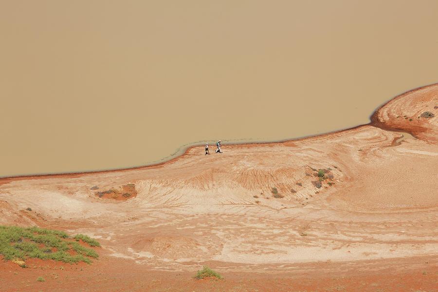 Tourists Passing Sossusvlei Pan Photograph by Bjarte Rettedal