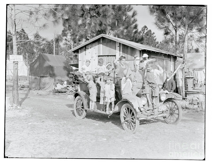 Tourists Riding In Car Photograph by Bettmann