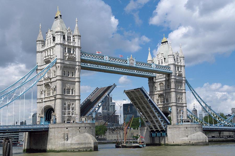 Tower Bridge Lifting To Let Through A Photograph by Joachim Messerschmidt
