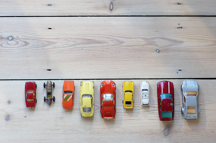 Toy Cars Lined Up In A Row On Floor Photograph by Dougal Waters