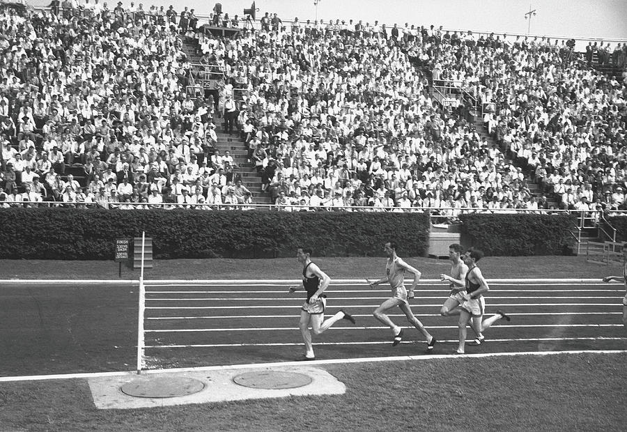 Track Athletes Running On Track, B&w Photograph by George Marks