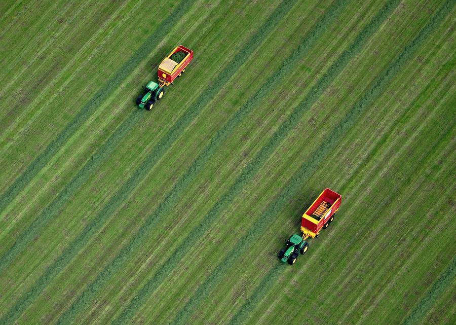 Tractor Cutting Grass Photograph by Powerfocusfotografie