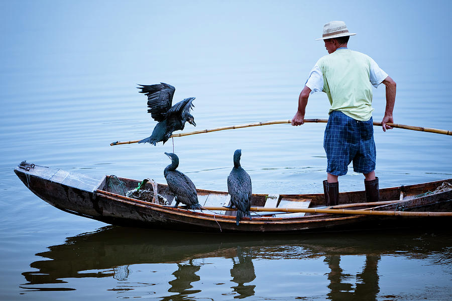 Traditional Chinese Fisherman On River Photograph by Chinaface