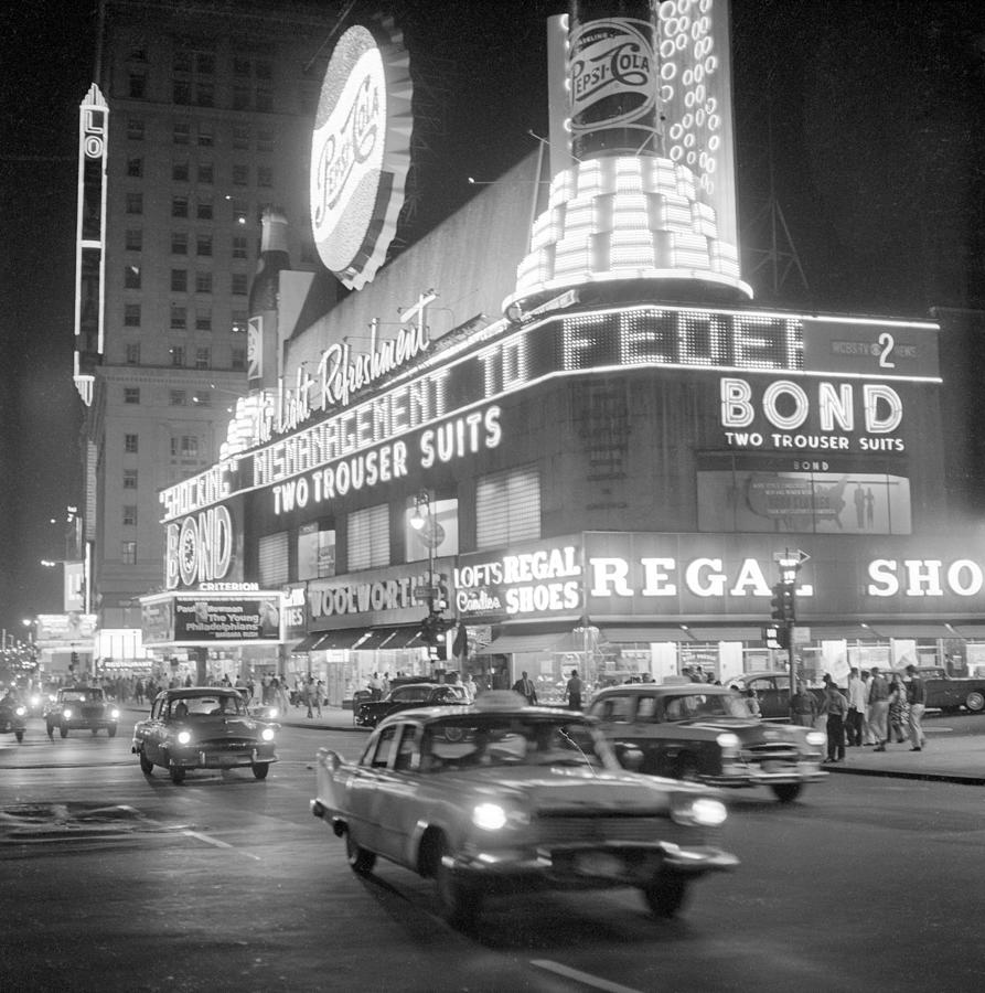 Traffic And Stores In Times Square Photograph by Bettmann