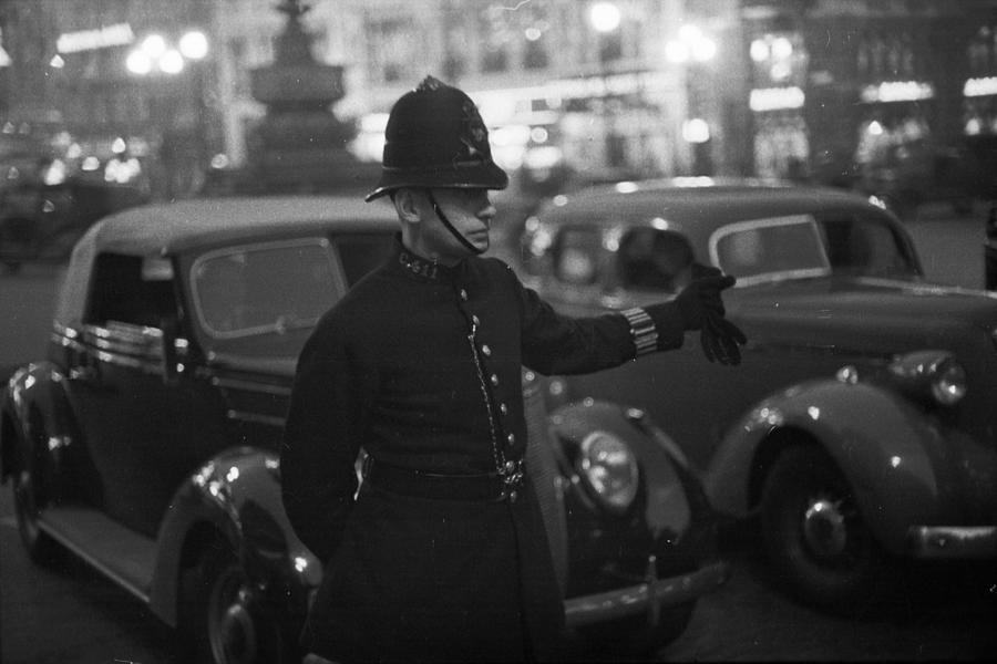 Traffic Cop Photograph by Kurt Hutton
