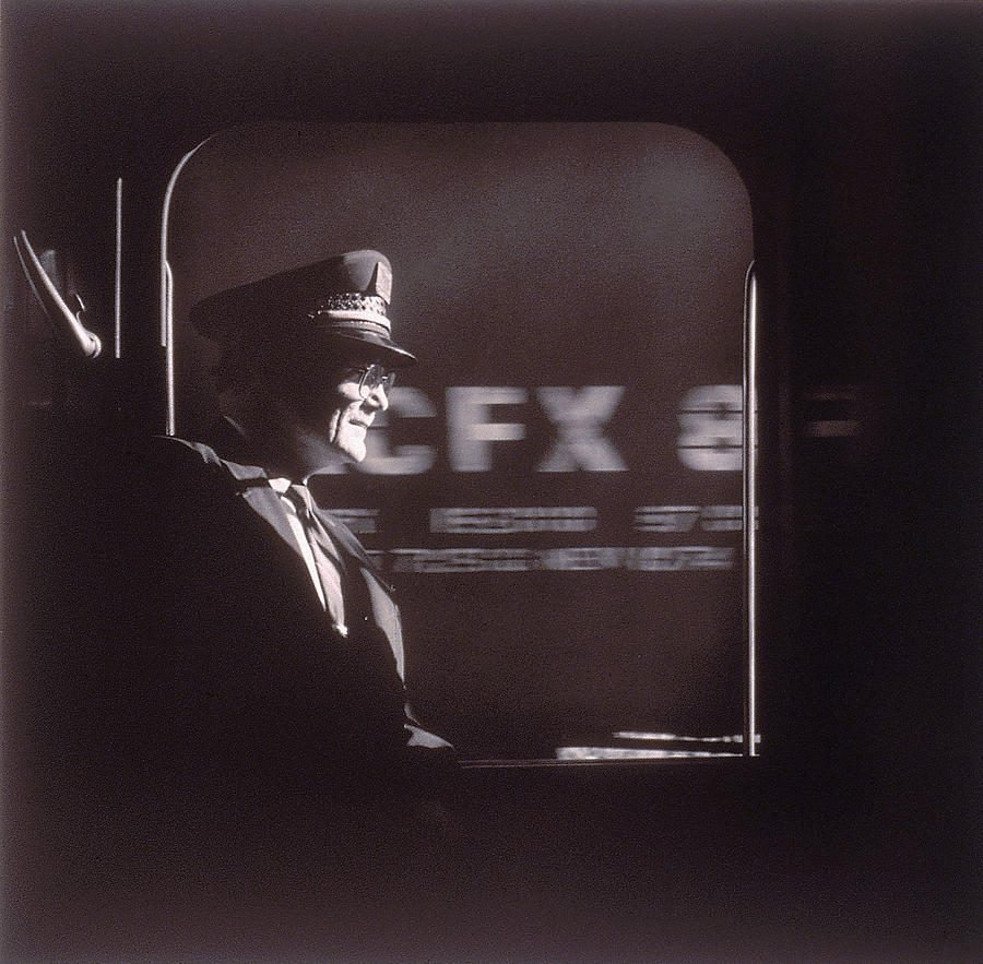 Train Conductor Looking Out Of Window Photograph by John Coletti