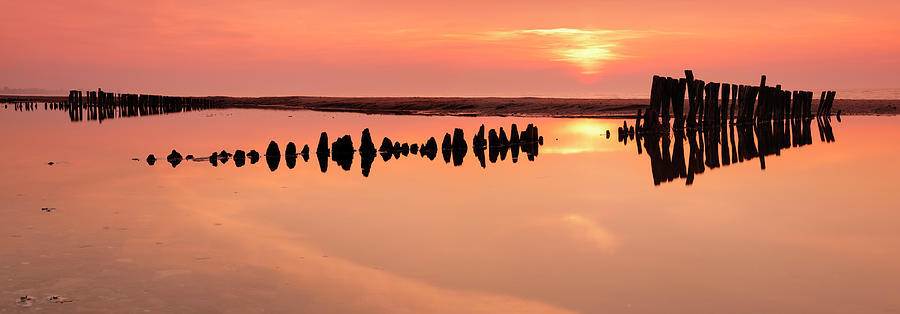 Water's Edge Photograph - Tranquil Coastal Sunrise With Old by Avtg
