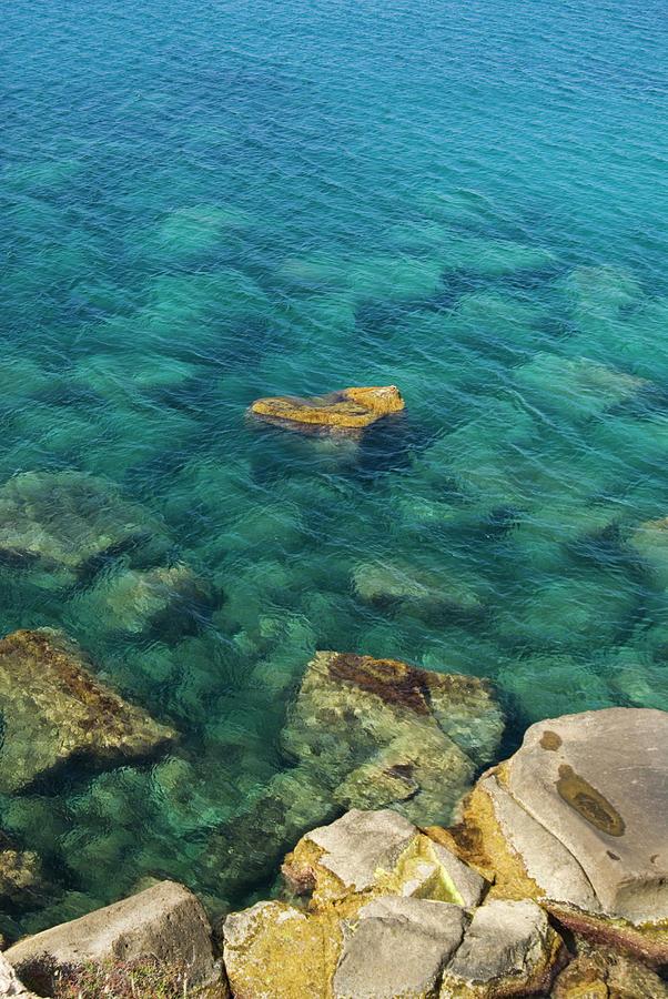 Transparent Water, Punta Colonne Photograph by Aldo Pavan