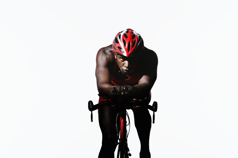 Triathlete Riding On Bicycle Photograph by Paul Taylor