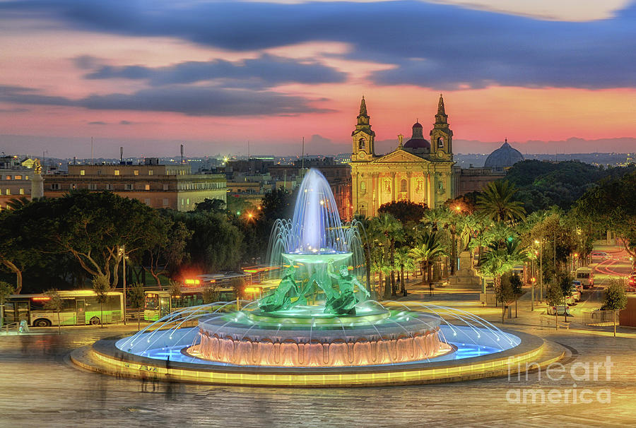 Triton Fountain of Valletta at sunset by Stephan Grixti