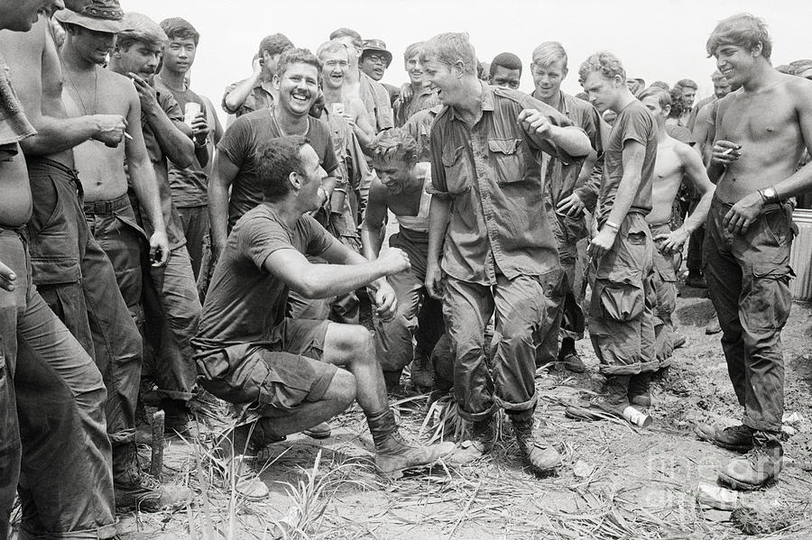 Troops Watch Soldiers Dance Photograph by Bettmann