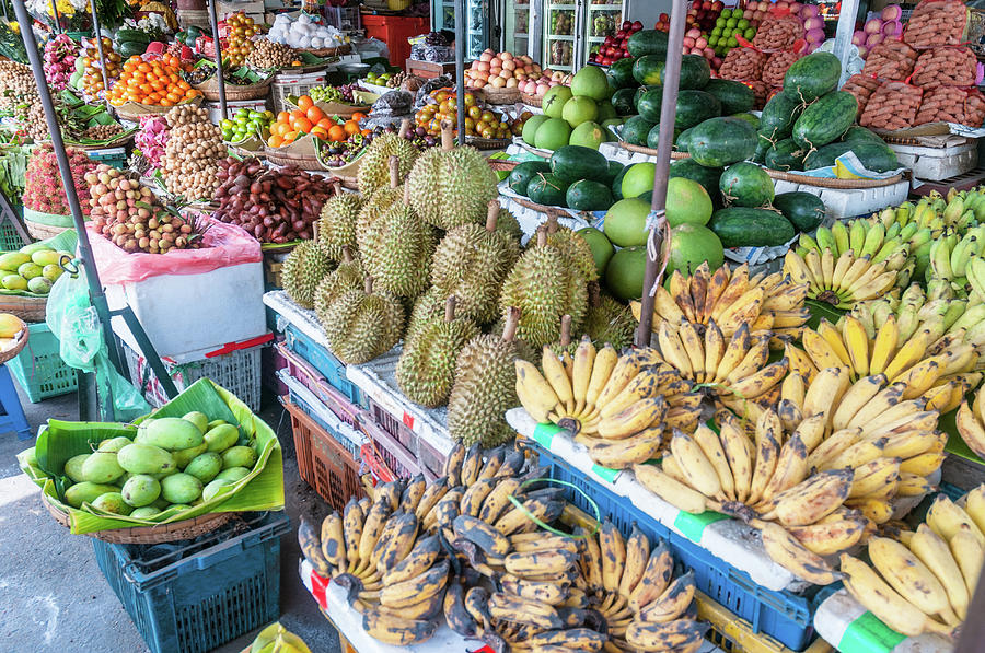 Tropical Fruit At A Street Market In Photograph by Tbradford