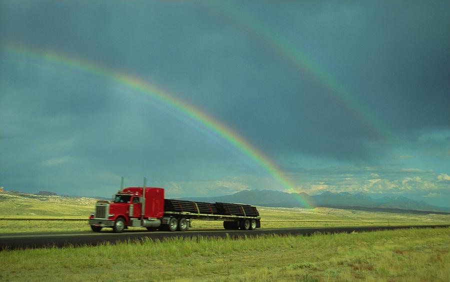 Truck With Rainbow Overhead, Blurred Photograph by Steve Satushek