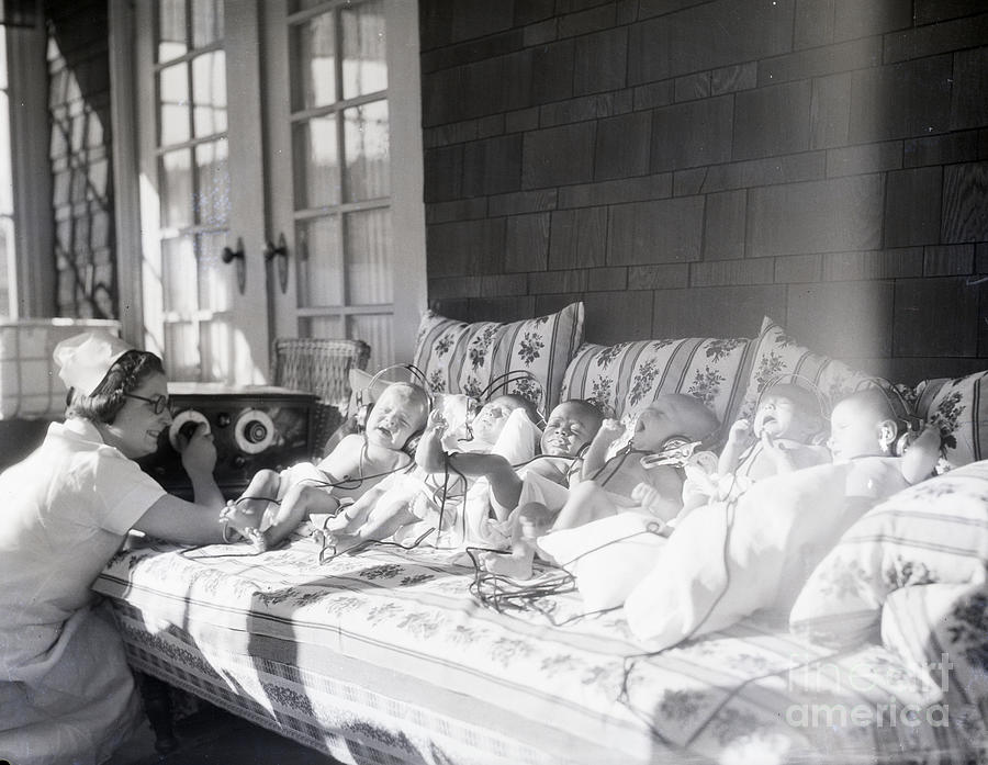 Trying To Calm Babies With Radio Photograph by Bettmann