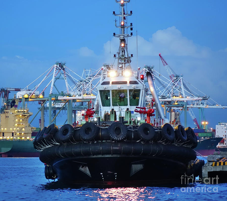 Tugboat with Large Tires at Dusk by Yali Shi