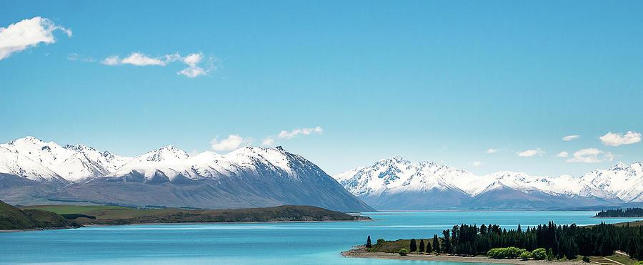 Panoramic View On New Zealands Lake Tekapo And Surrounding Mountains by Peter Kolejak