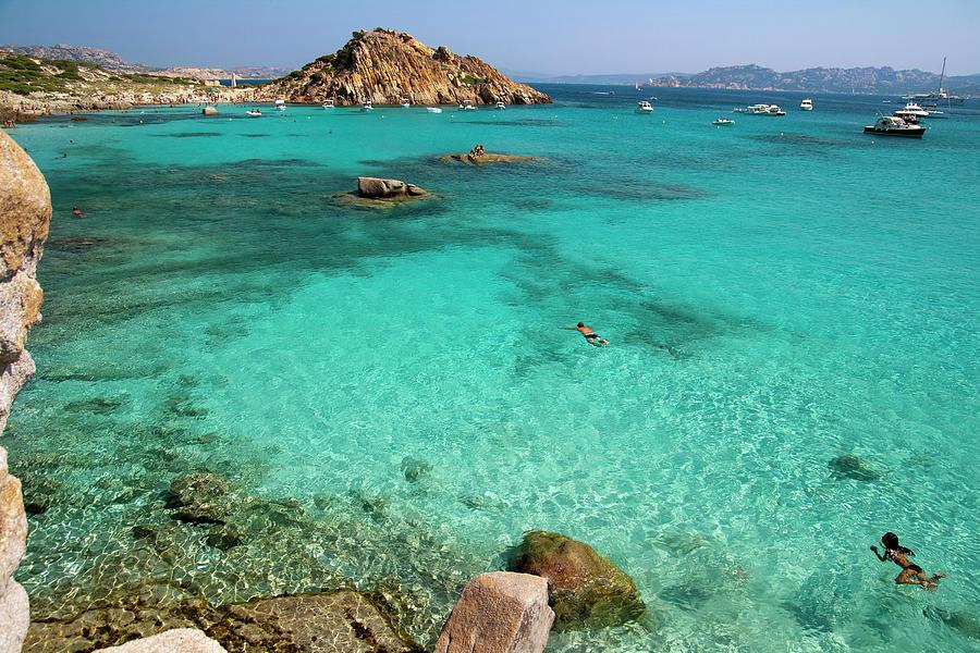 Turquoise Sea And Boats At La Maddalena Photograph by Vito elefante