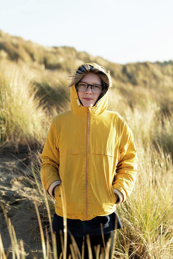 Tween Photograph - Tween Standing In Dunes Covered In Beach Grass On The California Coast by Cavan Images