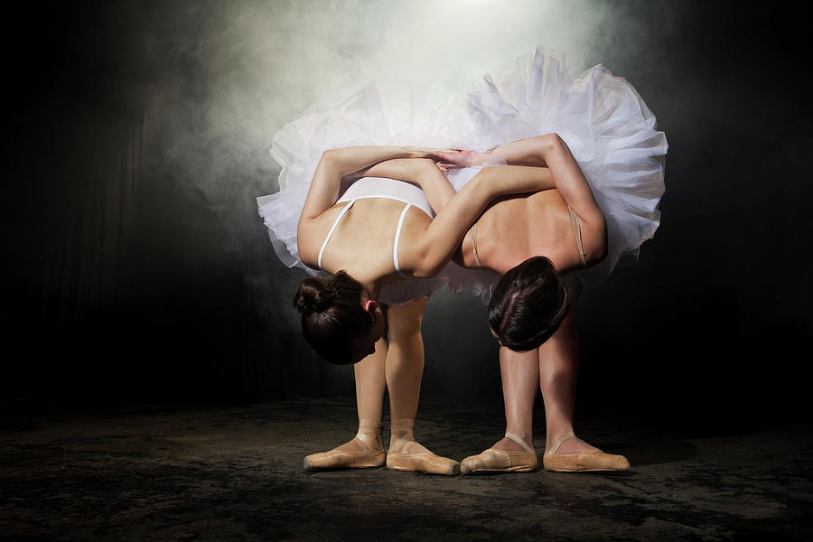 Two Ballerinas Stretching On Stage Photograph by Nisian Hughes
