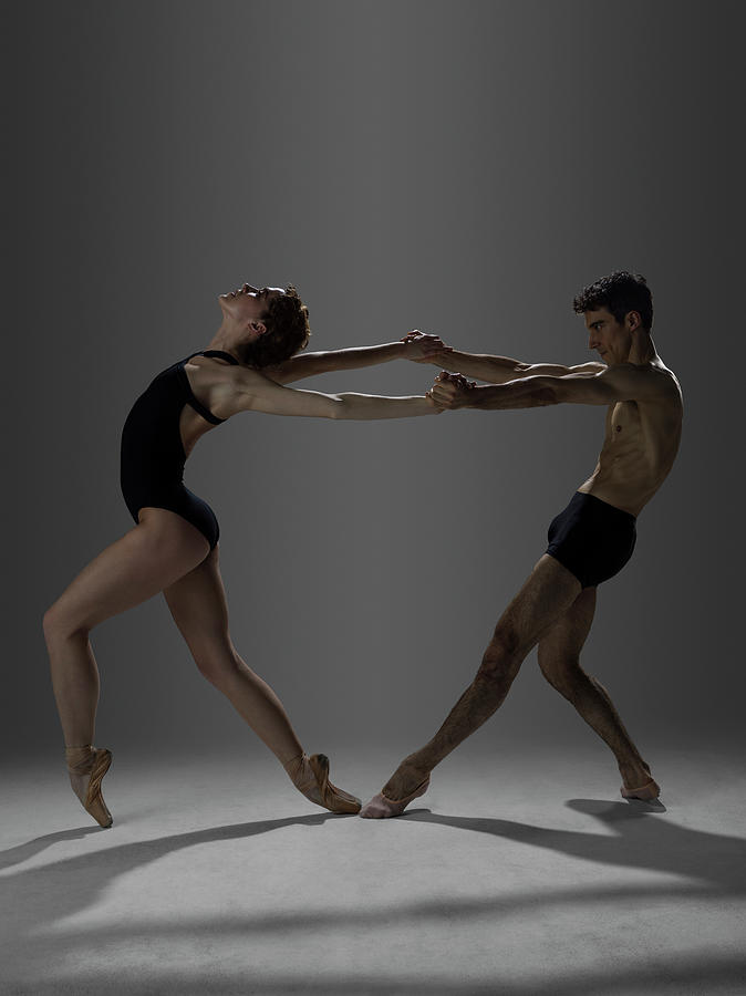Two Ballet Dancers Arch On Point Photograph by Nisian Hughes