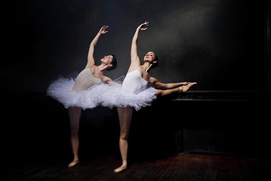 Two Ballet Dancers Stretching Photograph by Nisian Hughes