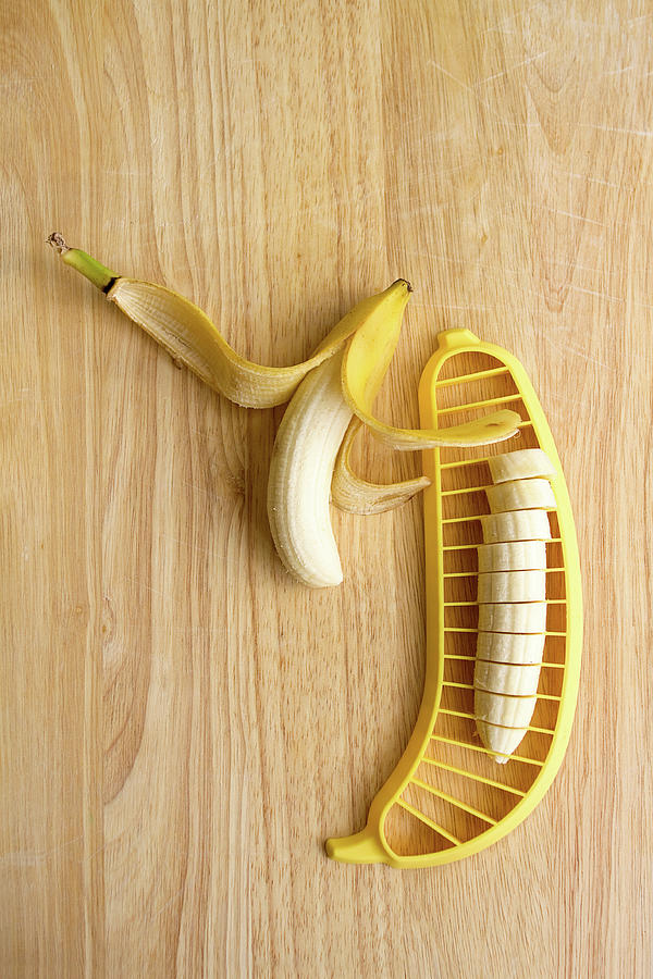 Two Bananas On Cutting Board Photograph by Kelly Sillaste