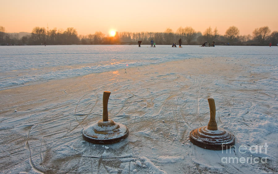 Game Photograph - Two Bavarian Curling Stones On A Frozen by Bernd Juergens