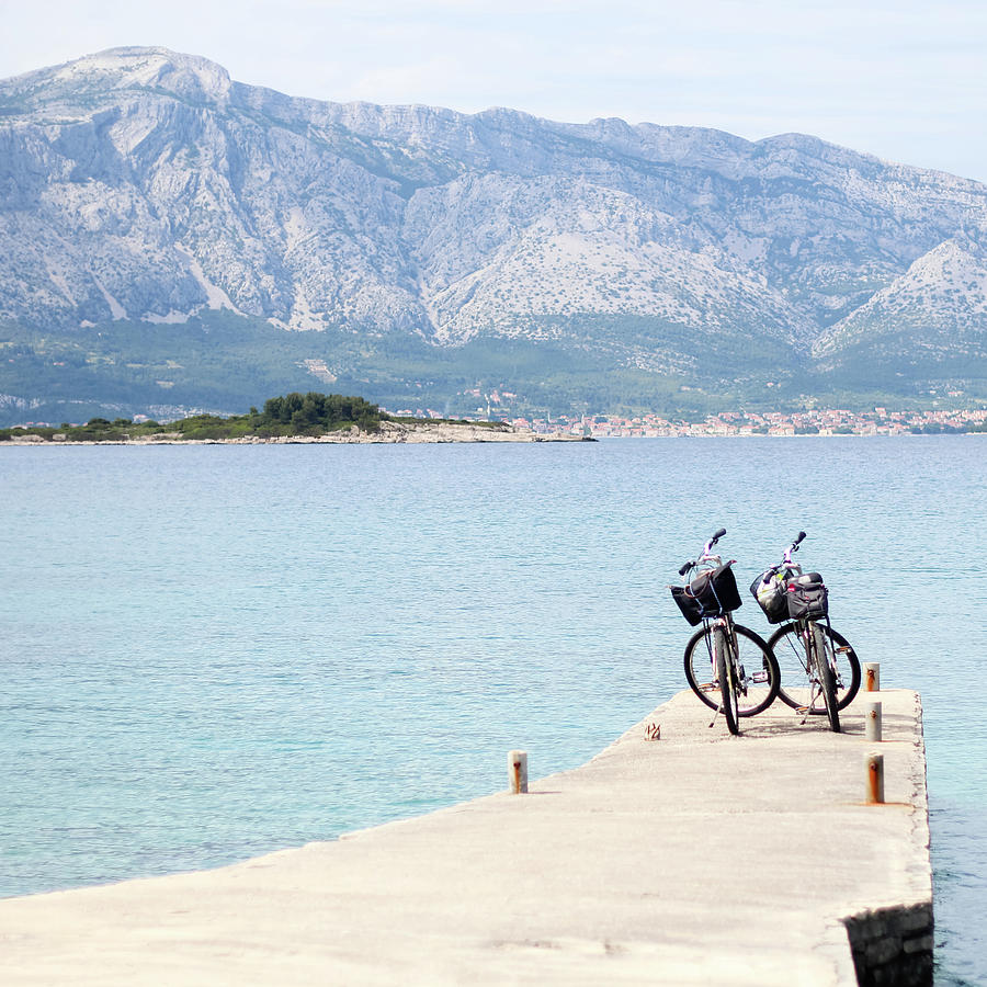 Two Bicycles On A Pier In Croatia Photograph by Carolin Voelker