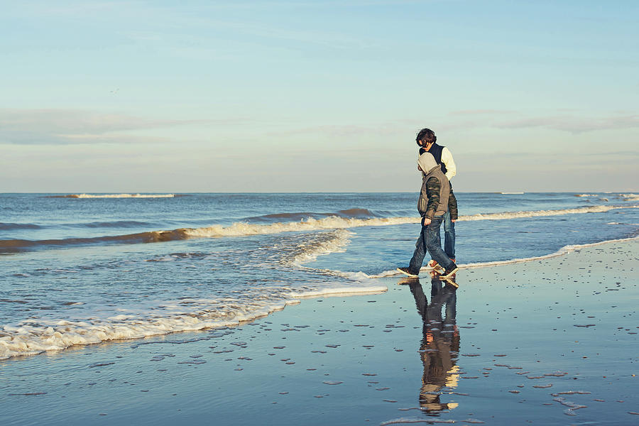 Two Boys Standing At The Ocean On A Photograph by Cindy Prins