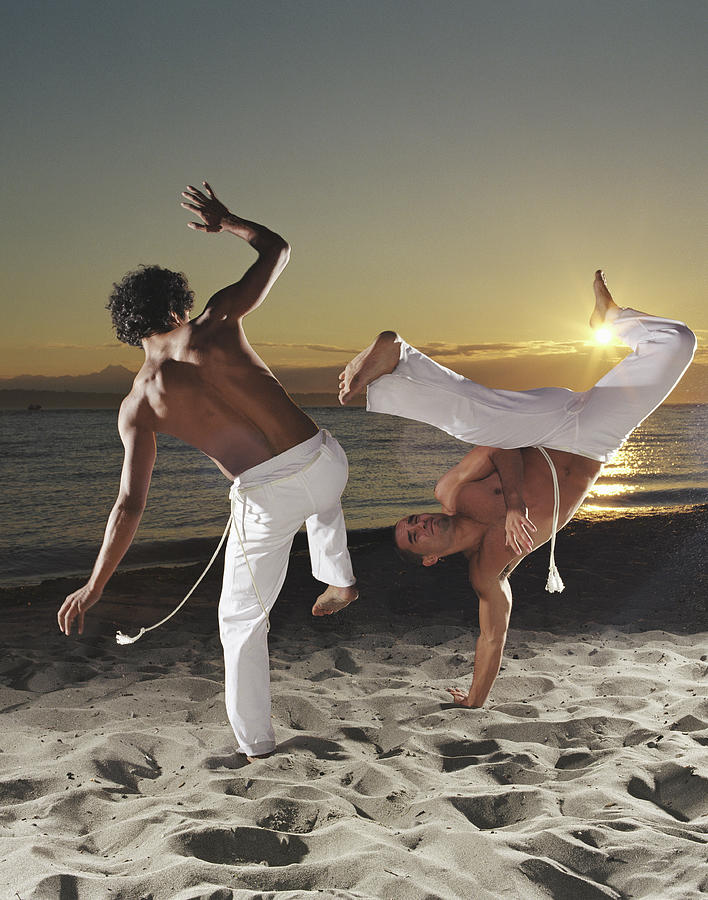 Two Capoeira Performers On Beach At Photograph by Ryan Mcvay
