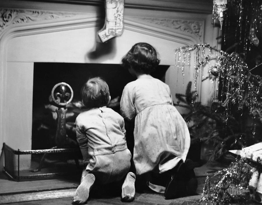 Two Children Waiting For Santa Claus Photograph by George Marks