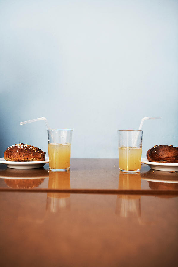 Two Cinnamon Buns And Two Glasses Of Photograph by Johner Images