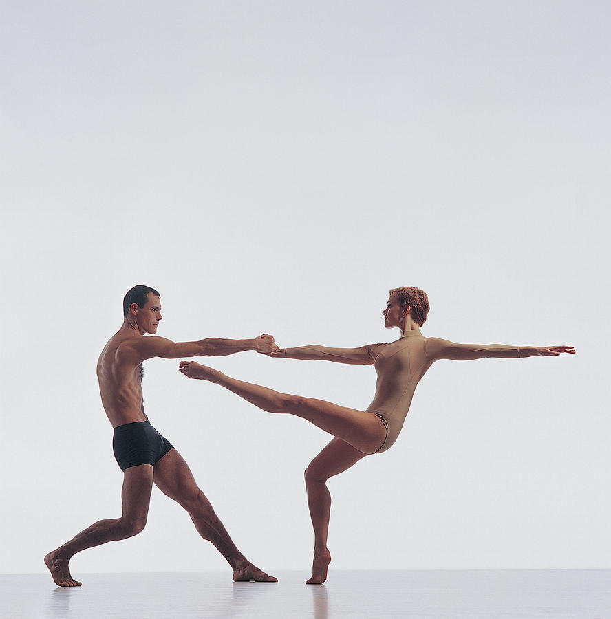 Two Dancers Holding Hands Photograph by Chris Nash