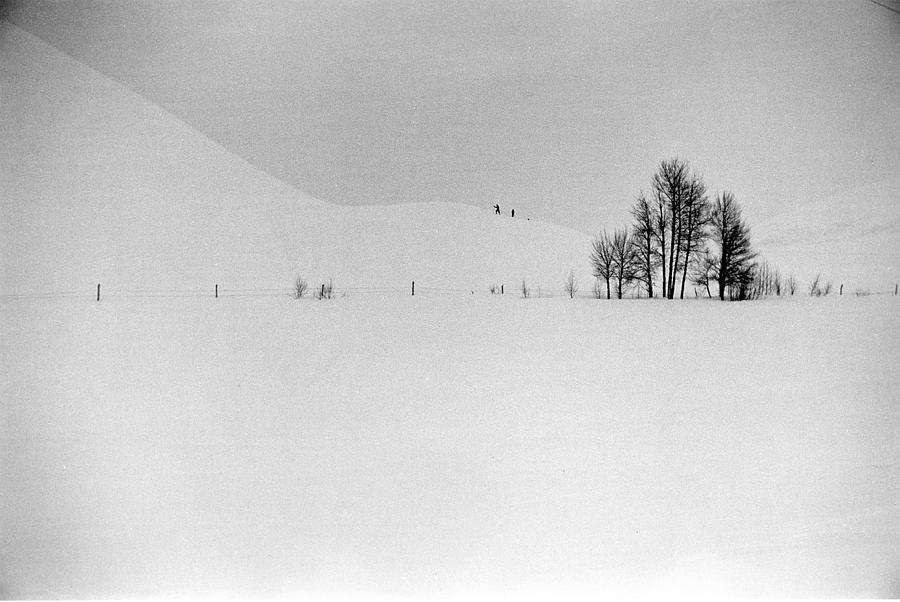 Two Distant Figures Climbing Hill In A Photograph by Alfred Eisenstaedt