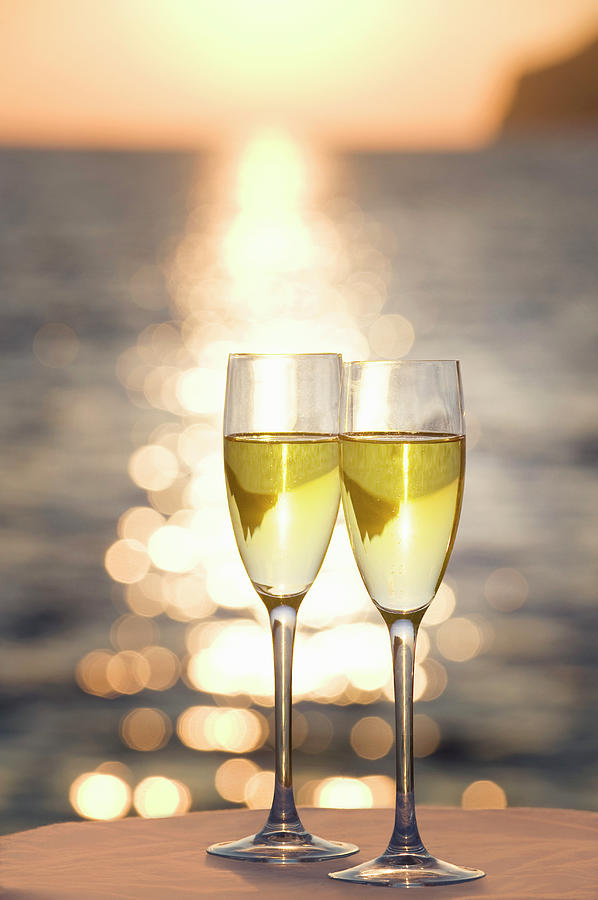 Two Glasses Of Champagne At Sunset Photograph by Bill Holden
