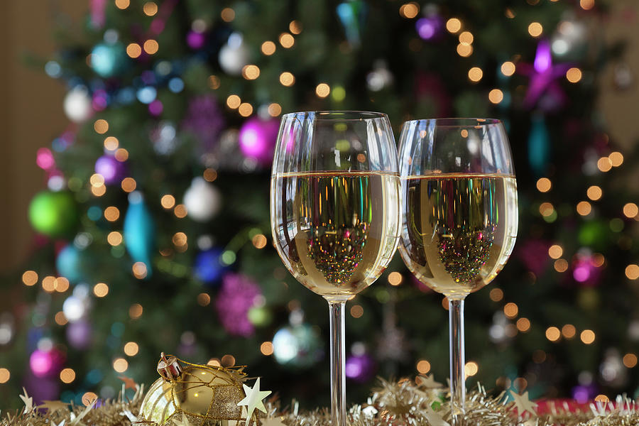Two Glasses Of White Wine By Christmas Photograph by Juan Silva