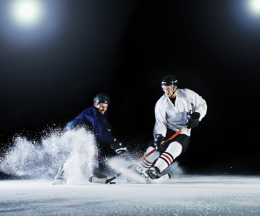 Two Ice Hockey Players Challenging For Photograph by Robert Decelis Ltd