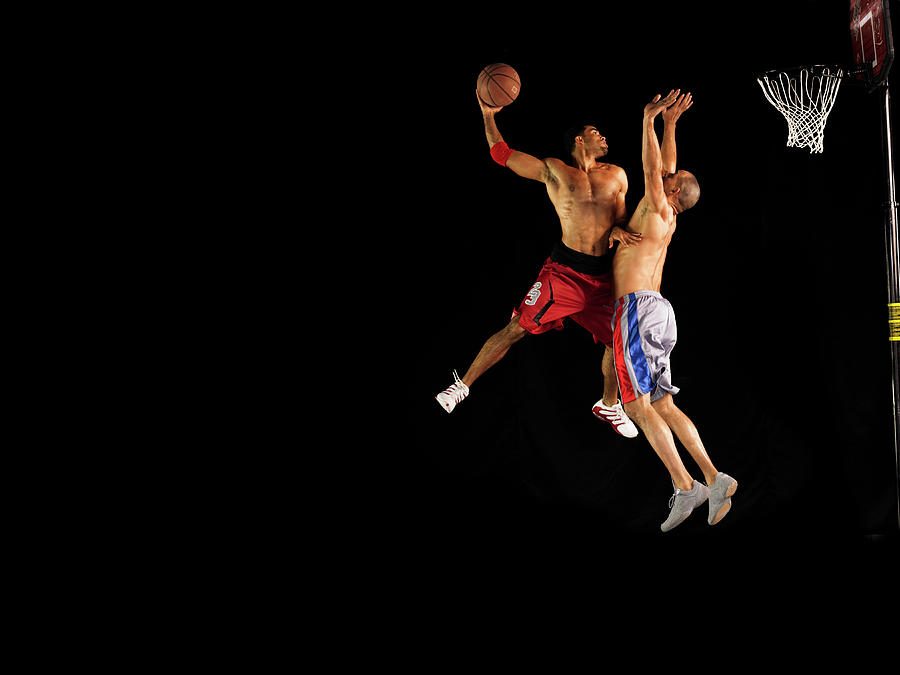 Two Male Basketball Players Jumping Mid Photograph by 10000 Hours
