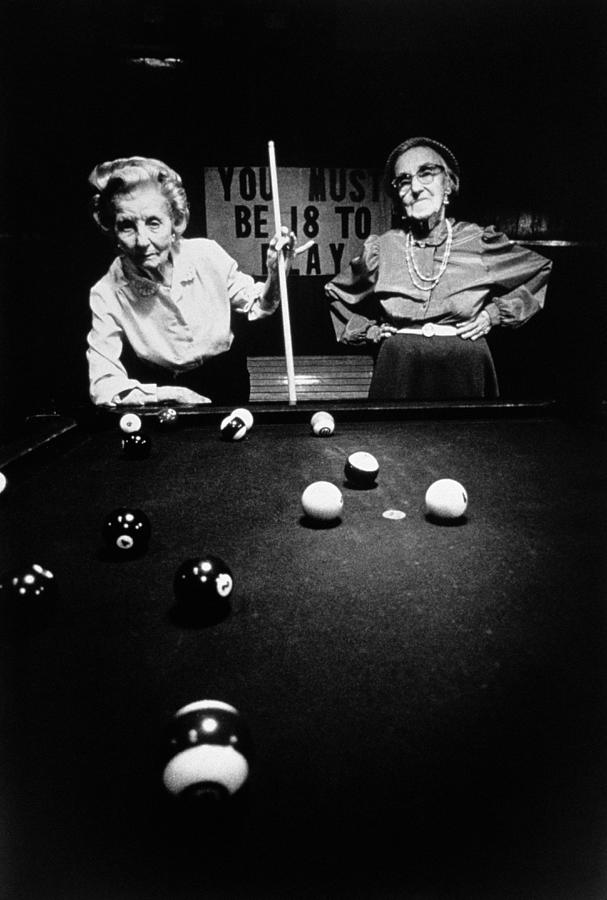 Two Mature Women Playing Pool In Black Photograph by Tim Bieber